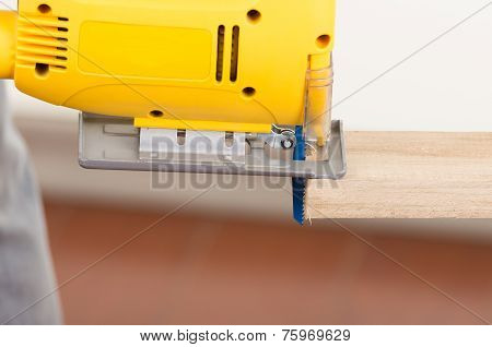 electric jigsaw tool cutting wood