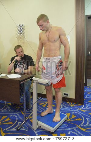 NOVOSIBIRSK, RUSSIA - NOVEMBER 7, 2014: World Champion in MMA Alexander Matmuratov during weigh-in before the Friendship Cup. The competitions include 10 kinds of martial arts