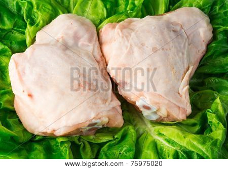 Fresh skinless chicken thighs on salad