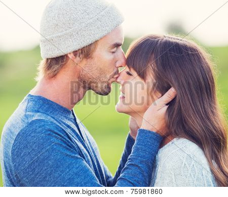 Happy Young Couple Having Fun Outdoors. Romantic Couple Kissing in Love on Country Road.