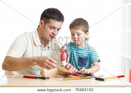 Dad and son child working with tools together