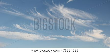 Blue Sky With Cirrus Clouds And Moon