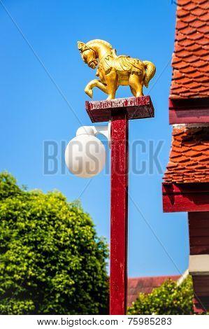A golden horse lamp