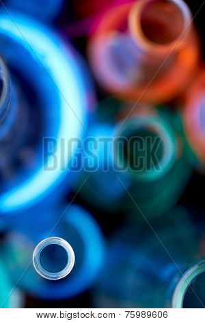 Above view of glass tubes with liquids, focus on neck of one of them
