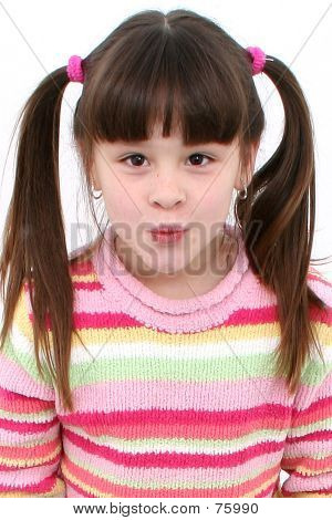 Seven Year Old Girl Blowing Kiss Over White