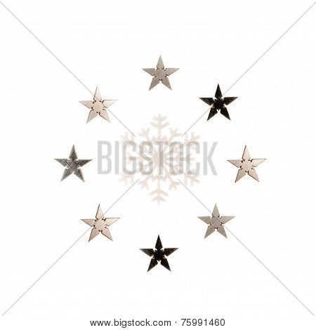 Snowflakes and asterisks around it isolated over white background
