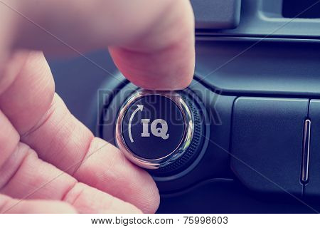Hand Of A Man Turning Up A Dial With The Word Iq And An Arrow