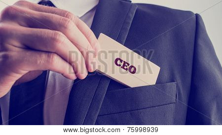 Businessman Showing A Card Reading Ceo