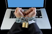 picture of addict  - Hands of caucasian businessman addicted to work tied and bond with iron chain handcuffed to computer laptop in workaholic internet slave and addict concept - JPG