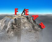 foto of overcoming obstacles  - businessman pushing red fear word down with dollar sign and wooden ladder on top of rocky mountain overcoming fear concept - JPG