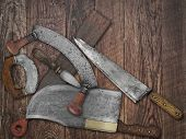 pic of leather tool  - faded colors if a vintage kitchen knives and sharpening tools collage over old wooden table space for your text - JPG