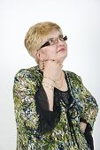Mature Woman With Glasses Thinking