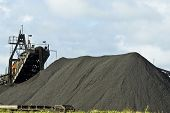 stock photo of export  - Large machinery creating manganese heaps ready for export - JPG