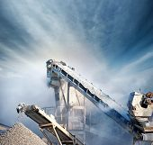 picture of production  - Heavy machinery of gravel production in quarry - JPG