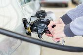 stock photo of gasoline station  - Petrol or gasoline being pumped into a motor vehicle car - JPG
