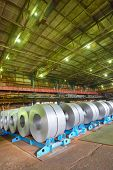 stock photo of coil  - galvanized steel coil in a warehouse - JPG