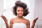 foto of pulling hair  - Beautiful  sad disappointed dark skinned girl being not able to  comb her hair looking at camera pulling her face with tangled disorder hair isolated on white background - JPG