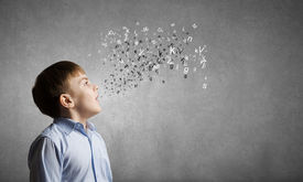 picture of pronunciation  - Cute boy of school age and letters flying around - JPG