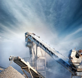 pic of production  - Heavy machinery of gravel production in quarry - JPG