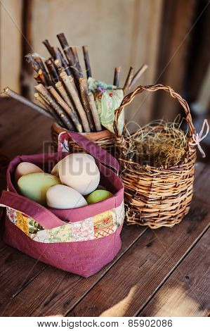 eggs for easter in quilted bag on wooden table in country house