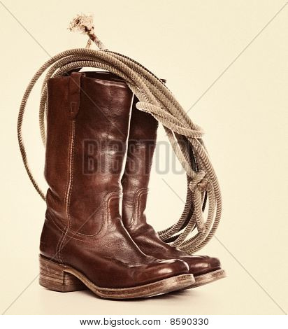 Cowboy boots and lasso rope