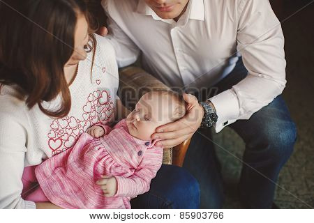 Happy young family with a baby