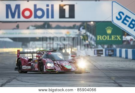 Sebring, FL - Mar 19, 2015:  The SpeedSource Mazda Prototype,races through the turns at 12 Hours of Sebring at Sebring Raceway in Sebring, FL.