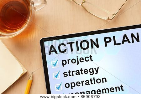 Tablet with words action plan.