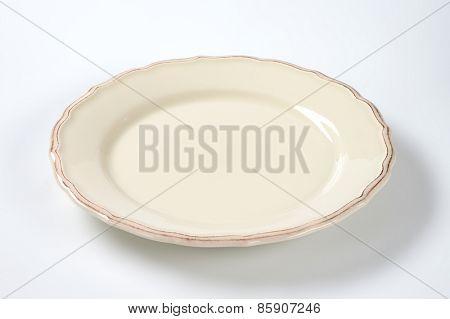 cream decorative plate on white background