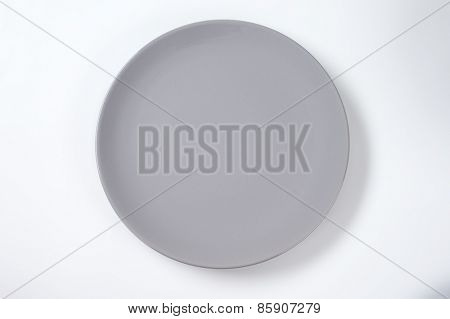 empty grey plate on white plate