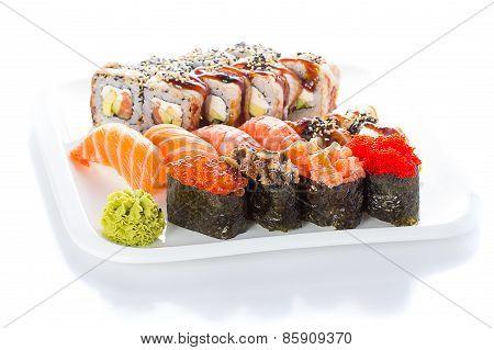 Set Og Sushi Roll Nigiri And Gunkan On White Plate Over White