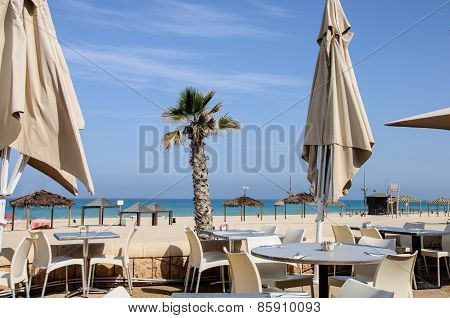 Sea And Beach Bar With Umbrellas