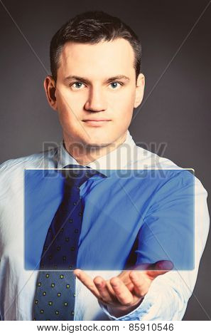 caucasian businessman is holding blank board in hands
