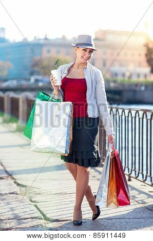 Happy Beautiful Woman With Shopping Bags And Cup Of Coffee