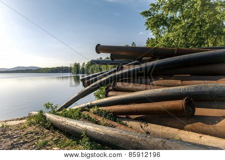 Rusty metal pipes in the forest