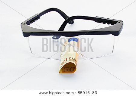 Protective Goggles And Fifty Euro Banknote