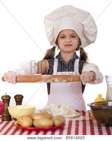 �?��?�¡ute little girl baking on kitchen and shows rolling-pin, isolated on a white background