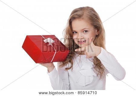 Happy little girl with gift box, studio on white background