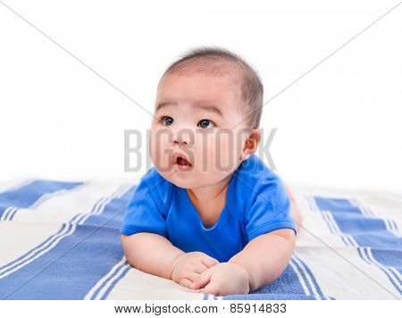 portrait of smiling baby from top on bed