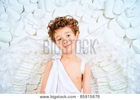 Portrait of a lovely little boy in a costume of angel. Cupid. Valentine's day.