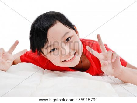 cute little girl in bed with hands gesture