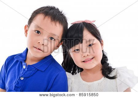 little boy and girl standing isolated