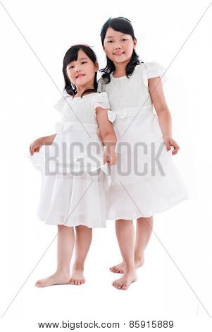 Full body Big sister, little sister in white dres on a white background