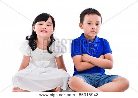 little boy and girl sitting isolated on white