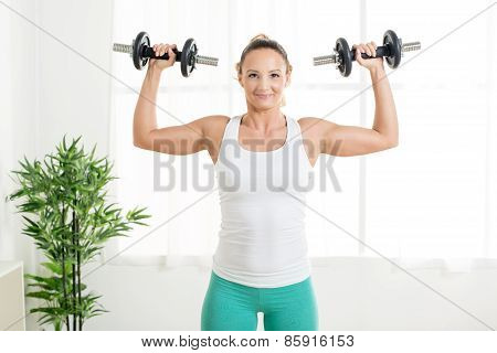 Woman Doing Exercises With Dumbbell