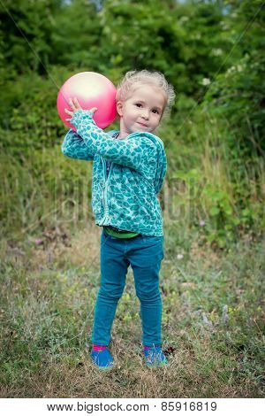 Happy Little Girl Playing With Ball