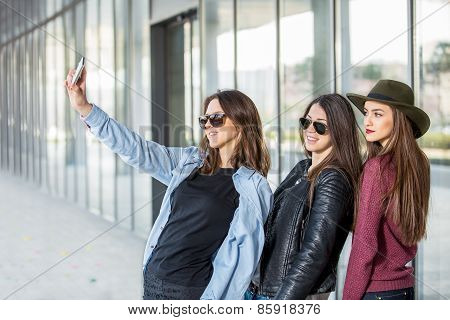 Happy girls taking a Selfie. Selective focus