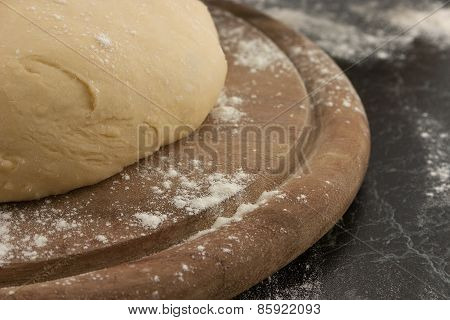 Freshly Prepared Dough On A Wooden Board. Selective Focus