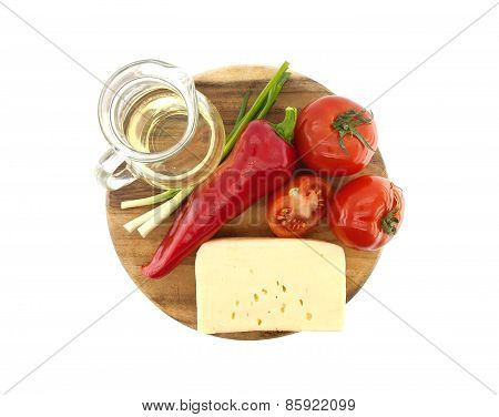 Vegetables, Oil And Cheese On Cutting Board, Isolated On White Background. Top View.