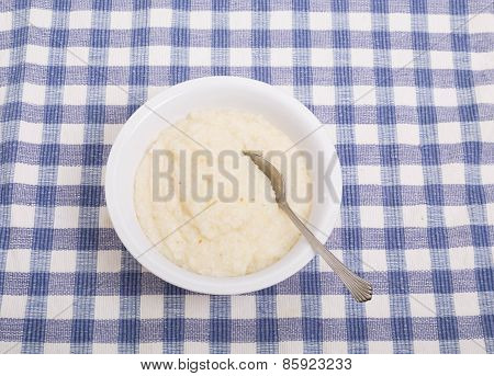 Bowl Of White Grits On Blue Check Tablecloth